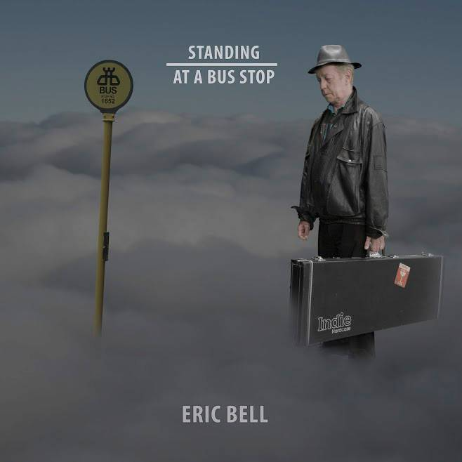 Eric Bell Standing At A Bus Stop